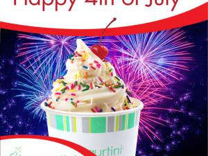 vanilla frozen yogurt in a yogurtini branded cup with fireworks in the background