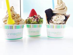 three branded cups of yogurt